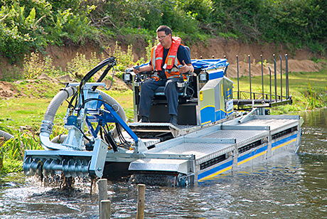 An amphibious tool carrier with pumping attachments.