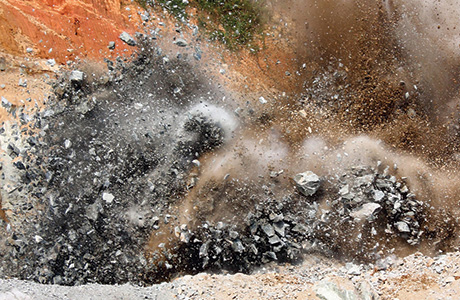 A blast at an open-cast mining quarry: Explosives residues have a negative impact on soil microbial communities and the establishment of vegetation.