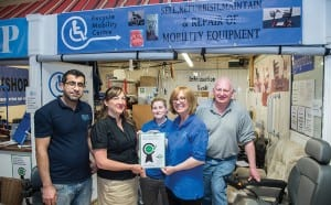 Sam Moir meets the Recycle Mobility team and presents them with their certificate for reaching the Revolve standard.