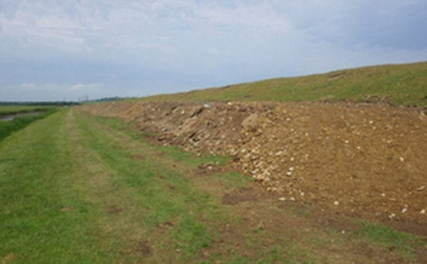 Fines issued after waste illegally used for flood defence
