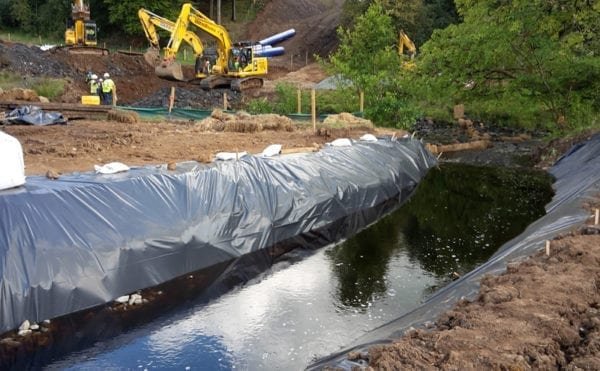 A river runs through it: Utility completes key diversion work during pipe installation project near Glasgow