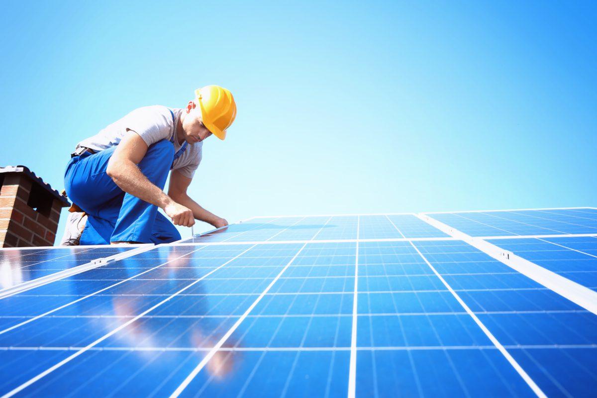 worker-installing-solar-panels