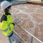 worker analysing water treatment